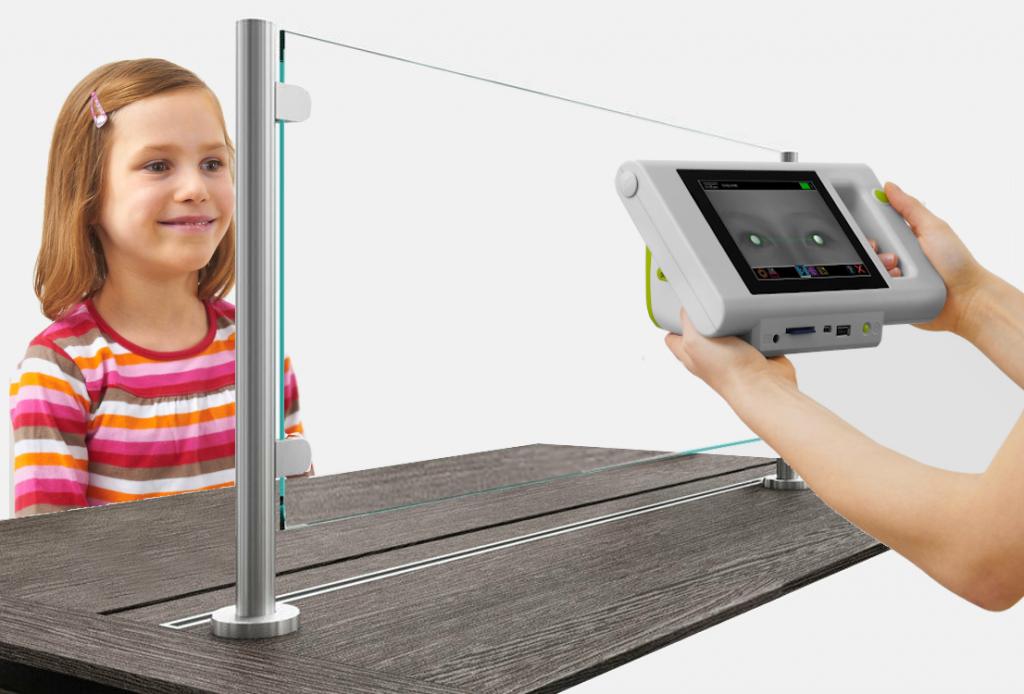 Plusoptix device measures refraction through sneeze guard