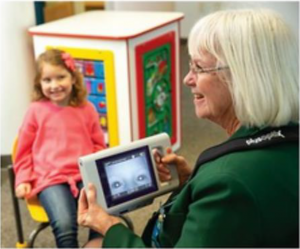 Oregon State Elks Association President Mary Williams check the vision of Alayna, a four-year-old girl, during a vision screening event organized by OHSU Elks Preschool Vision Screening Program.